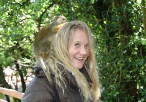 Anna has a monkey on her back and South Lake Safari zoo in Cumbria, England.